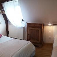 Chambre Anna Gavalda composée d'un lit simple et un lit double.